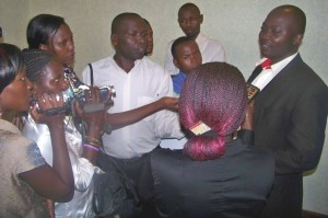 Journalists interviewing CEHURD's programmes coordinator prior to the hearing of the appeal