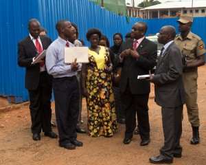 His Lordship Benjamin Kabiito makes an observation during the locus visit