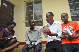 Part of the CEHURD team interviewing a community member